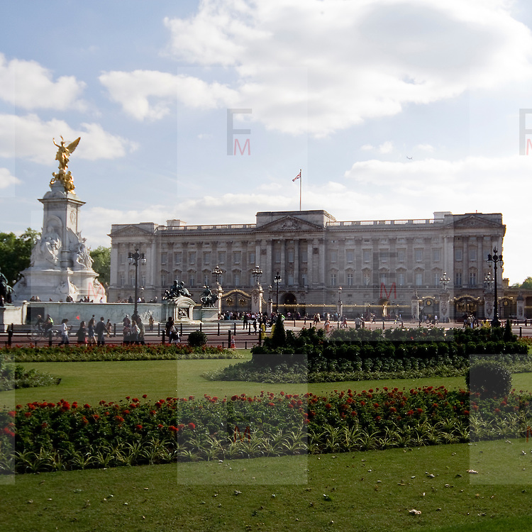 Buckingham Palace the official London residence of the British monarch. In foreground is visible the Victoria Memorial.