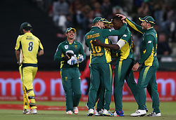 South African captain Faf du Plessis and David Miller of South Africa congratulate Kagiso Rabada of South Africa for bowling Mitchell Marsh of Australia during the 5th ODI match between South Africa and Australia held at Newlands Stadium in Cape Town, South Africa on the 12th October  2016<br /> <br /> Photo by: Shaun Roy/ RealTime Images