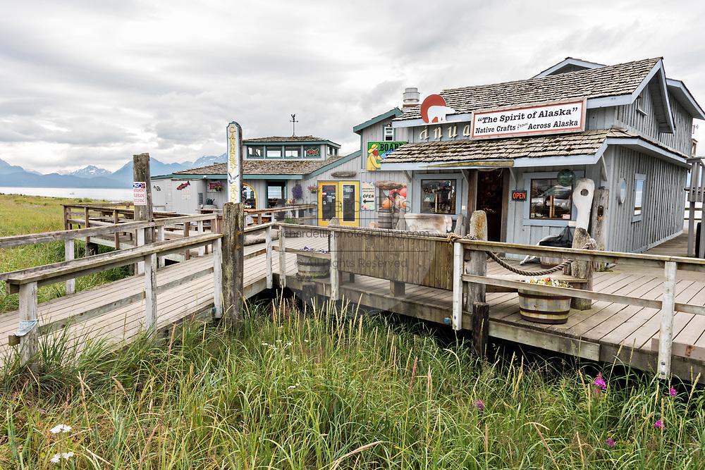 Restaurants and shops along the marsh boardwalk on Homer Spit on Kamishak Bay in Homer, Alaska.