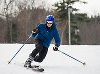 Skiers and riders take to the slopes at Gunstock Mountain during opening weekend.  (Karen Bobotas/for the Laconia Daily Sun)