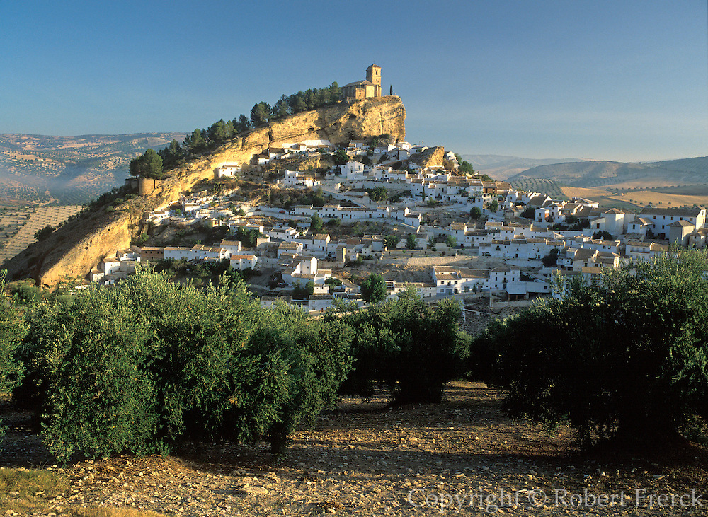SPAIN, ANDALUSIA MONTEFRIO; a beautiful 'pueblo blanco' or white village with church on hill and surrounded by olive groves; east of Granada