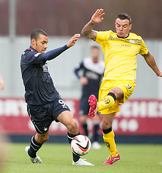 Falkirk's Phil Roberts and Queen of the South's Derek Lyle.<br /> Falkirk 1 v 0 Queen of the South, Scottish Championship game today at the Falkirk Stadium.<br /> © Michael Schofield.