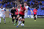 Oldham Athletic's  Charlie MacDonald gets away from Tranmere Rovers' Ash Taylor.  Skybet football league 1match, Tranmere Rovers v Oldham Athletic at Prenton Park in Birkenhead, England on Saturday 1st March 2014.<br /> pic by Chris Stading, Andrew Orchard sports photography.
