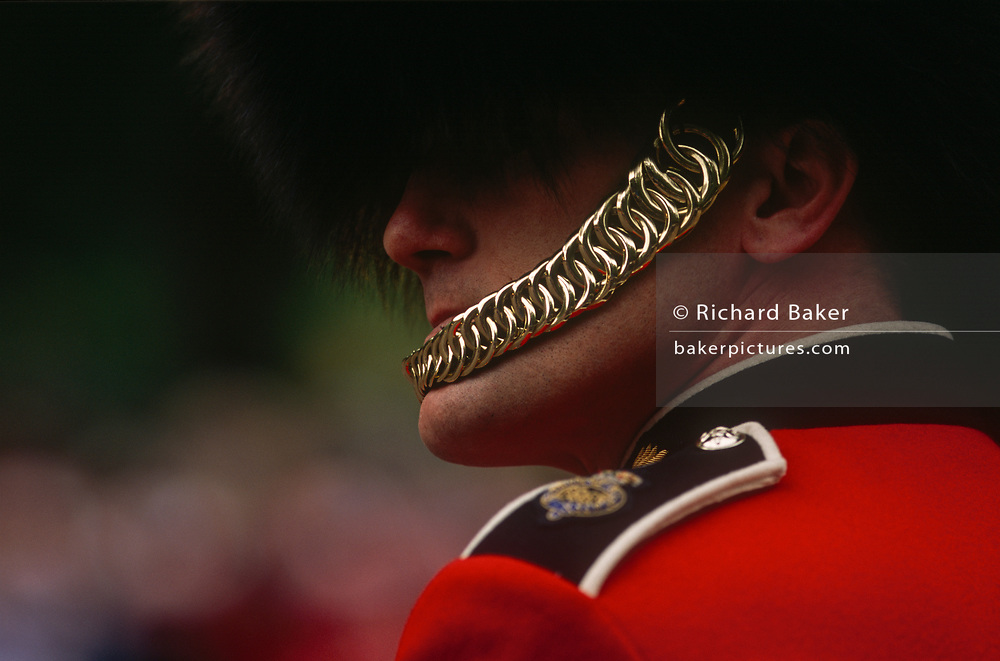 A detail of a Grenadier Guardsman's chinstrap during a ceremonial parade for Queen Elizabeth's Golden Jubilee celebrations, on 3rd June 2002, in London, England.