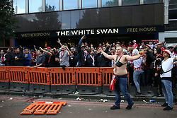 14 September 2017 -  UEFA Europa League (Group H) - Arsenal v FC Koln - An FC Koln fan kicks a traffic fence outside the White Swan at Highbury Corner - Photo: Mark Leech/Offside
