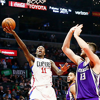 26 March 2016: LA Clippers guard Jamal Crawford (11) goes for the layup past Sacramento Kings center Georgios Papagiannis (13) during the Sacramento Kings 98-97 victory over the Los Angeles Clippers, at the Staples Center, Los Angeles, California, USA.