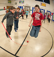 There was a whole lot of jumping going on at Gilford Elementary School during the Jump for Heart event that kicked off with third graders Nate Jude, Harry Meehan and Jaxen Cole on Wednesday morning.  (Karen Bobotas/for the Laconia Daily Sun)