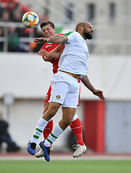 Gibraltar's Jayce Olivero (left) and Republic of Ireland's David McGoldrick (right) battle for the ball during the UEFA Euro 2020 Qualifying, Group D match at the Victoria Stadium, Gibraltar.