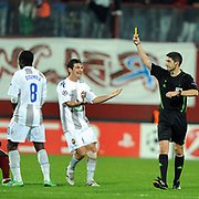 Referee's Alberto Undiano MALLENCO show the yellow card to CSKA Moskva's Seydou DOUMBIA (L) during their UEFA Champions League group stage matchday 4 soccer match Trabzonspor between CSKA Moskva at the Avni Aker Stadium at Trabzon Turkey on Wednesday, 02 November 2011. Photo by TURKPIX