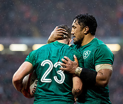Jordan Larmour of Ireland celebrates scoring his sides first try with team-mate Bundee Aki<br /> <br /> Photographer Simon King/Replay Images<br /> <br /> Six Nations Round 5 - Wales v Ireland - Saturday 16th March 2019 - Principality Stadium - Cardiff<br /> <br /> World Copyright © Replay Images . All rights reserved. info@replayimages.co.uk - http://replayimages.co.uk