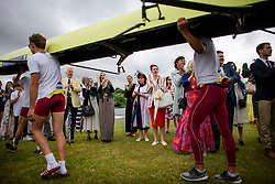 © Licensed to London News Pictures. 28/06/2017. London, UK. Spectators watch Shiplake College carry their boat to water on day one of the Henley Royal Regatta, set on the River Thames by the town of Henley-on-Thames in England.  Established in 1839, the five day international rowing event, raced over a course of 2,112 meters (1 mile 550 yards), is considered an important part of the English social season. Photo credit: Ben Cawthra/LNP