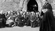 Praying outside The Friary, Killarney inthe 1950's.<br /> Picture by Louis MacMonagle