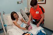 2011-02-18-San Juan,PR_El Grupo de Puerto Rico Dog, Theraphy Dogs visita a pacientes y sus cuidadores del Hospital Auxilio Mutuo para traerle un poco de alegria durante su estadia en el hospital.En la foto Aida Davila junto a Natalia Sonromá y su perrita Fifi.