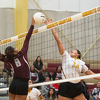 Rehoboth's Jessica Triplett (13) and Ramah's Shayla Poncho (8) both reach for the ball above the net during their match Thursday evening in Rehoboth.