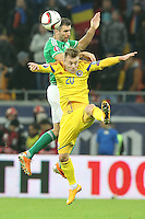 ROMANIA, Bucharest: Romania's Alexandru Maxim (R) and Northern Ireland's Aaron Hughes (L) vie for the ball during the Euro 2016 Group F qualifying football match Romania vs Northern Ireland in Bucharest, Romania on November 14, 2014.
