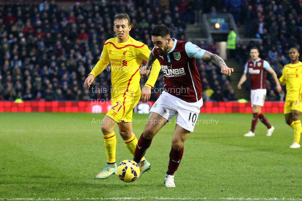 Danny Ings of Burnley goes past Lucas Leiva of Liverpool. Barclays Premier league match, Burnley v Liverpool at Turf Moor in Burnley, Lancs on Boxing Day, Friday 26th December 2014.<br /> pic by Chris Stading, Andrew Orchard sports photography.