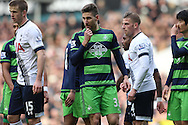 Federico Fernandez of Swansea City (c)  looks on. Barclays Premier league match, Tottenham Hotspur v Swansea city at White Hart Lane in London on Sunday 28th February 2016.<br /> pic by John Patrick Fletcher, Andrew Orchard sports photography.