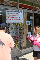 A total eclipse swept through the tiny town of Spring City, Tennessee on Monday afternoon. Thousands from all over the United States and a few from around the world flocked to the city with a population of under 2,000 (according to the 2010 census). The city is situated dead-center of the path of totality of the eclipse, providing a spectacular view and one of the longest durations of totality (over 2 minutes). There were no dedicated parking areas or viewing spots, so cars simply pulled into the town and parked wherever they could, lining up in rows down the streets and along the railroad tracks that run through the town. Local businesses were thriving with the influx, and many were sold out of 'eclipse merchandise' such as t-shirts within hours and were taking online orders for people who missed their chance to purchase a t-shirt on the spot. Eric Henson, manager at the Movie Depot, a movie-rental store, still had a few t-shirts and said his store was 'doing great' with all the new business. Another local resident, Amanda Gornik, came out to sell painted rocks that she decorated on the spot with eclipse images or anything a customer asked for. 21 Aug 2017 Pictured: Total eclipse in Spring City, Tennessee. Photo credit: Mom&Paparazzi / MEGA TheMegaAgency.com +1 888 505 6342