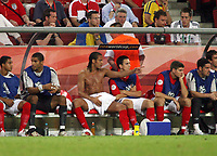 Photo: Chris Ratcliffe.<br /> Sweden v England. FIFA World Cup 2006. 20/06/2006.<br /> Rio Ferdinand of England sits with an ice pack on his groin.