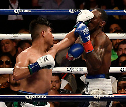 7-28-18. Los Angeles CA. (in white/Green trunks)  Mikey Garcia became the 10th lightweight champion to unify the division with a unanimous decision after 12 rounds with Robert Easter Jr. Saturday. Mikey Garcia took the win for the world title unification at the Staple Center. .Photo by Gene Blevins/LA DailyNews/SCNG/ZumaPress (Credit Image: © Gene Blevins via ZUMA Wire)