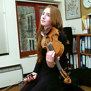 A teenage girl having a violin lesson at Ampleforth College, North Yorkshire, UK. Ampleforth College is a coeducational independent day and boarding school in the village of Ampleforth, North Yorkshire, England. It opened in 1802 as a boys' school, and is run by the Benedictine monks and lay staff of Ampleforth Abbey.