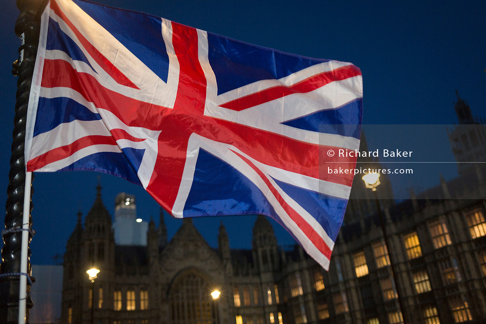 As the vote of no confidence for Prime Minister Theresa May's leadership in the Conservative Party occurs because of her handling of the Brexit deal with the EU, a Union Jack flag flies opposite Parliament in Westminster, on 12th December 2018, in London, England.