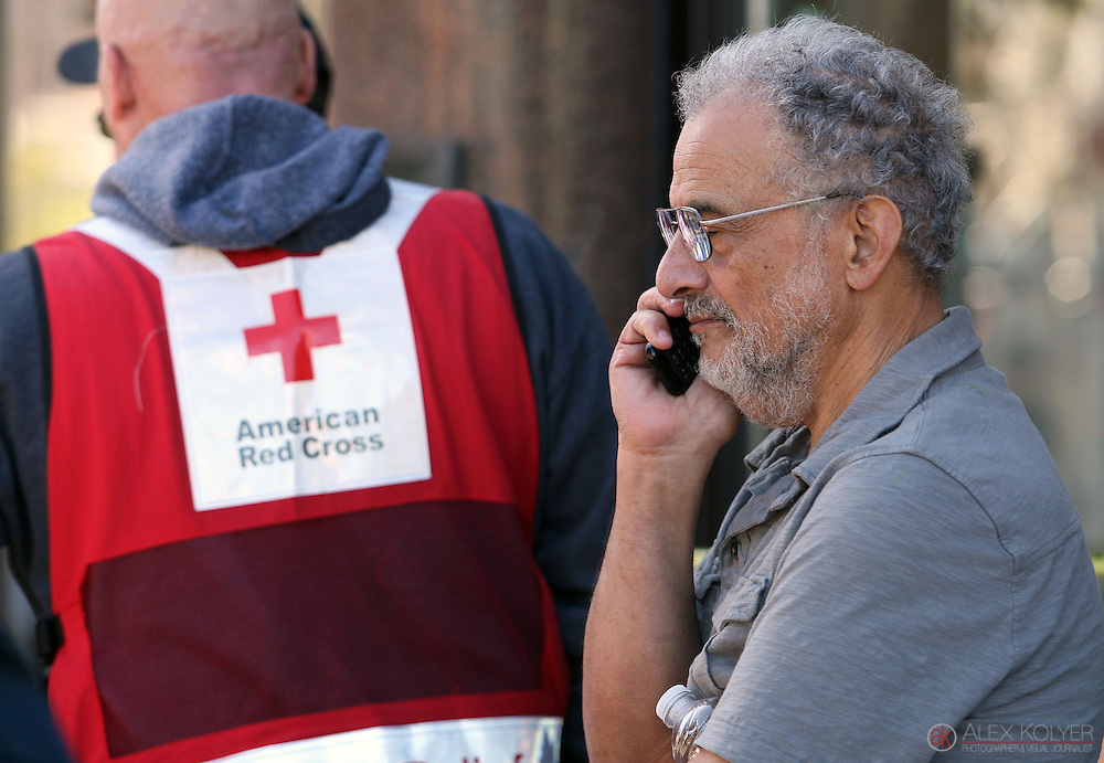 9/13/13--Winona<br /> Ahmed El-Afandi, the owner of the building that housed the Islamic Center of Winona, speaks on the phone as firefighters battle a blaze that destroyed three buildings Friday, Sept. 13, 2013. (Photo for MPR News by Alex Kolyer)
