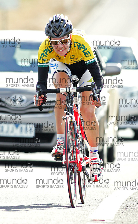 (10 Jul 2011---Canberra, Australia) Grace Sulzberger (Pure Tasmania) makes a break on an uphill corner to ride away to a win in the DBR Australia 2011 Junior and Women's Canberra Tour at the Stromlo Forest Park circuit in Canberra, ACT. Copyright Sean Burges / Mundo Sport Images, 2011