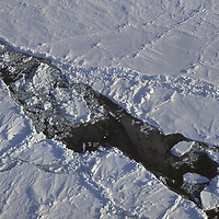 Overhead view of ice and open leads at the North Pole.