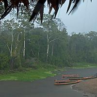 Rain falls into the Yanayacu River next to the Amazon Refuge Wildlife Conservation Center in Peru's Amazon Jungle.