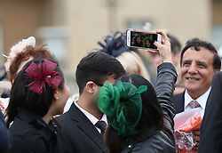 Guests take a selfie during a Royal Garden Party at Buckingham Palace in London.