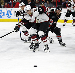 March 3, 2017 - Raleigh, NC, USA - The Canes Patrick Brown (36) battles the Arizona Coyotes' Christian Dvorak (18) and Brendan Perlini (29) for the puck during the second period of an NHL game played between the Carolina Hurricanes and the Arizona Coyotes at PNC Arena on March 3, 2017 in Raleigh, N.C. (Credit Image: © Chris Seward/TNS via ZUMA Wire)
