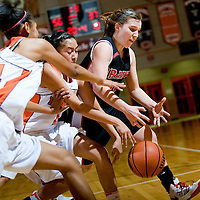 011913  Adron Gardner/Independent<br /> <br /> Gallup Bengals Ni'asia McIntosh (34), left, and Rachelle Blackgoat (1) chase down Grants Pirate Haley Hall (22) at Gallup High School Tuesday.