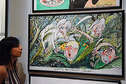 """© Licensed to London News Pictures. 31/03/2017. London, UK. A staff member views """"Lost in the Brexit Jungle"""", 2017, by Gerald Scarfe (Est GBP 5-7k).  The work depicts Theresa May, Boris Johnson, Nigel Farage and Alex Salmond).  Press preview of """"Made in Britain"""" at Sotheby's in New Bond Street.  The auction on 5 April celebrates innovative British art in the twentieth century as well as artwork by political cartoonist Gerald Scarfe. Photo credit : Stephen Chung/LNP"""