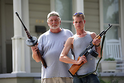 31 August 2008. New Orleans, Louisiana. USA..Hurricane Gustav preparations. Armed and staying.  l/r Tom Richard with his Thompson sub machine gun and Justin Workmon with an AK-47 have fresh ammunition and clean guns and are ready to protect their property if need be. Uptown residents refusing to leave and ready to deal with any potential threat from looters..Photo; Charlie Varley.