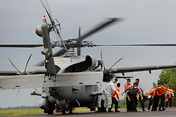 Indonesian search and rescue members carry debris from an MH-60R Seahawk helicopter in Pangkalan Bun, Indonesia, Jan. 4, 2015. An Indonesian pilot taking part in the multinational search operation said here on Sunday that three more bodies were found in AirAsia crash site off Borneo coast(bxq). EXPA Pictures © 2015, PhotoCredit: EXPA/ Photoshot/ Agung Kuncahya B.<br /> <br /> *****ATTENTION - for AUT, SLO, CRO, SRB, BIH, MAZ only*****