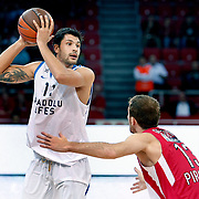 Anadolu Efes's Cenk AKYOL (L) during their Two Nations Cup basketball match Anadolu Efes between Olympiacos at Abdi Ipekci Arena in Istanbul Turkey on Sunday 02 October 2011. Photo by TURKPIX