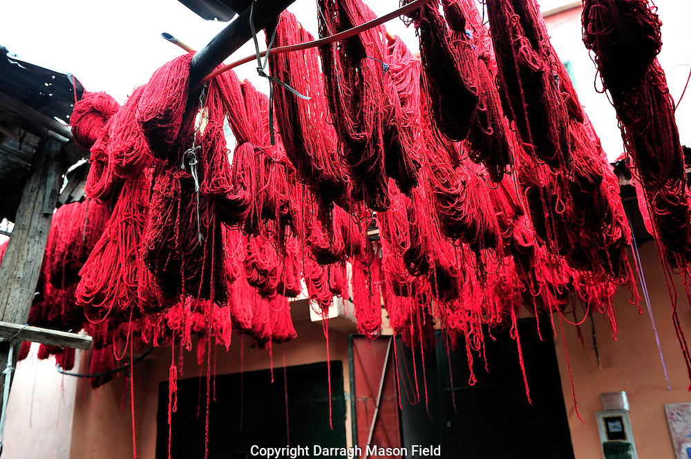 Red wool drying after dying