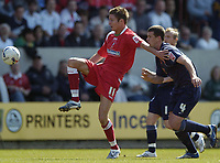 Photo: Jonathan Butler.<br /> Swindon Town v Walsall. Coca Cola League 2. 05/05/2007.<br /> An outstretched Barry Corr of Swindon holds off Anthony Gerrard of Walsall.