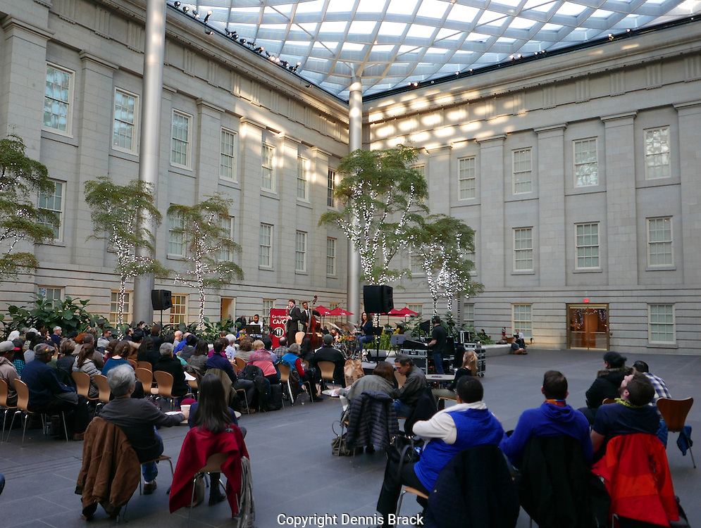 A concert in the atrium of the National Portrait Gallery in Washington, DC,  The Kenny Nunn Quartet is performing.<br /> Photo by Dennis Brack