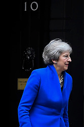 © Licensed to London News Pictures. 24/10/2018. LONDON, UK.  Theresa May, Prime Minister, prepares to greet King Willem-Alexander and Queen Maxima of the Netherlands at Number 10 Downing Street.  The King and Queen are in the UK on a state visit aimed at strengthening the bonds between the two nations.  Photo credit: Stephen Chung/LNP