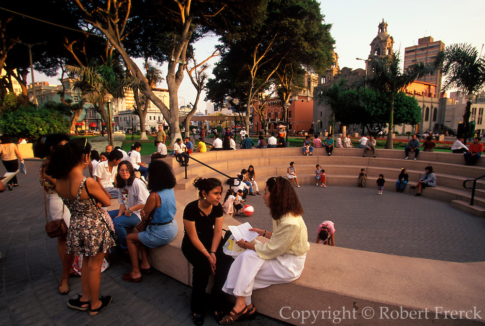PERU, LIMA, MIRAFLORES SUBURB Parque Central, popular gathering spot in busy suburb with upscale banks, shops and apartments