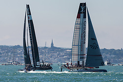 © Licensed to London News Pictures. 23/07/2016. Portsmouth, United Kingdom. Teams Japan SoftBank (left) and Team France Groupama (right) competing in the first day of racing for the America's Cup World Series (ACWS) in Portsmouth this weekend, 22nd-24th July 2016. British Olympic sailing legend, Sir Ben Ainslie, is leading his all-British team, Land Rover BAR, against other teams in a battle to qualify for a place in the two team America's Cup final, to be held in Bermuda in 2017. Photo credit: Rob Arnold/LNP