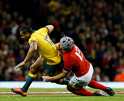 Kurtley Beale of Australia is tackled by Jonathan Davies of Wales<br /> <br /> Photographer Simon King/Replay Images<br /> <br /> Under Armour Series - Wales v Australia - Saturday 10th November 2018 - Principality Stadium - Cardiff<br /> <br /> World Copyright © Replay Images . All rights reserved. info@replayimages.co.uk - http://replayimages.co.uk