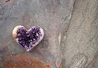 Crystal Heart Amethyst. This healer stone is violet quartz that contains iron and trace minerals. The angel frequency sacred geometry aligns the Third Eye, Crown and Etheric Chakras. Still Life Photography.