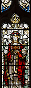 Stained glass window of Jesus Christ in his majesty wearing a crown, church of Saint Mary, Friston, Suffolk, England, UK
