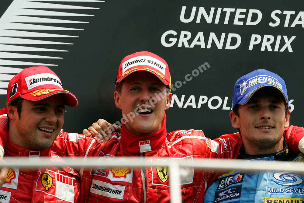 Ferrari drivers Felipe Massa and Michael Schumacher with Giancarlo Fisihella (Renault) on the podium after the 2006 United States Grand Prix in Indianapolis. Photo: Grand Prix Photo