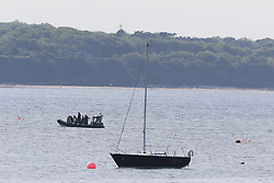 A Garda water unit in Skerries harbour as a search and rescue operation is under way for a missing fisherman after a boat sank in the Irish Sea.