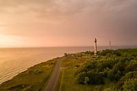 Aerial view of Pakri lighthouse on Pakri peninsula at sunset in Estonia.