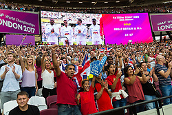 London, August 13 2017 . Fans cheer the British 4x100 team as they are awarded gold during their medal ceremony on day ten of the IAAF London 2017 world Championships at the London Stadium. © Paul Davey.